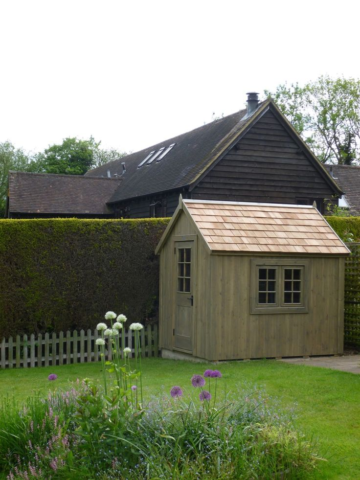 Potting shed with cedar shingle roof and finished with a natural wood stain