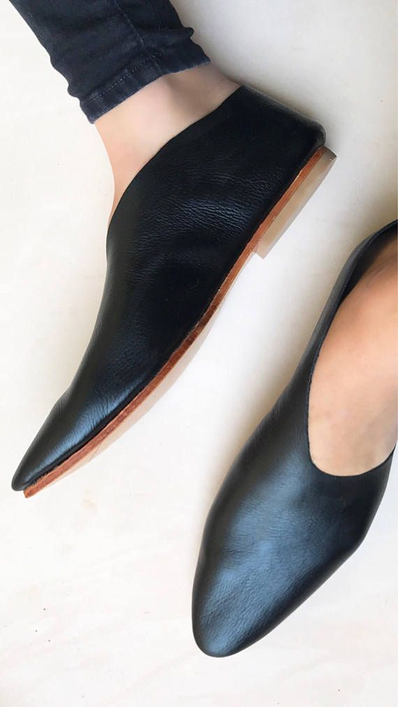 Rilee Shoes Minimal black leather pointy asymmetrical bootie