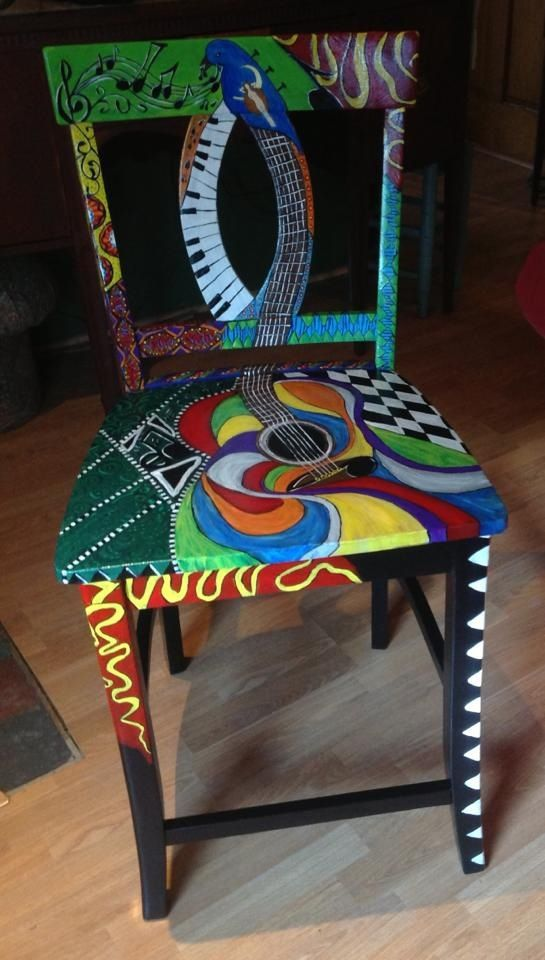 Paint chair with guitar and music theme.