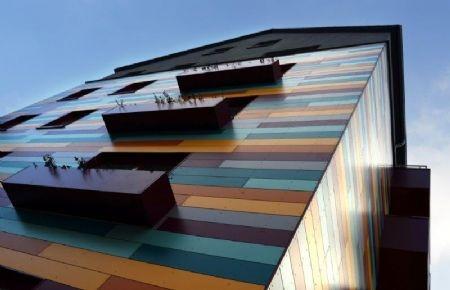 Architectura - Sociaal flatgebouw krijgt kleurrijk 'patchwork'-geveldesign @ROCKPANEL Group