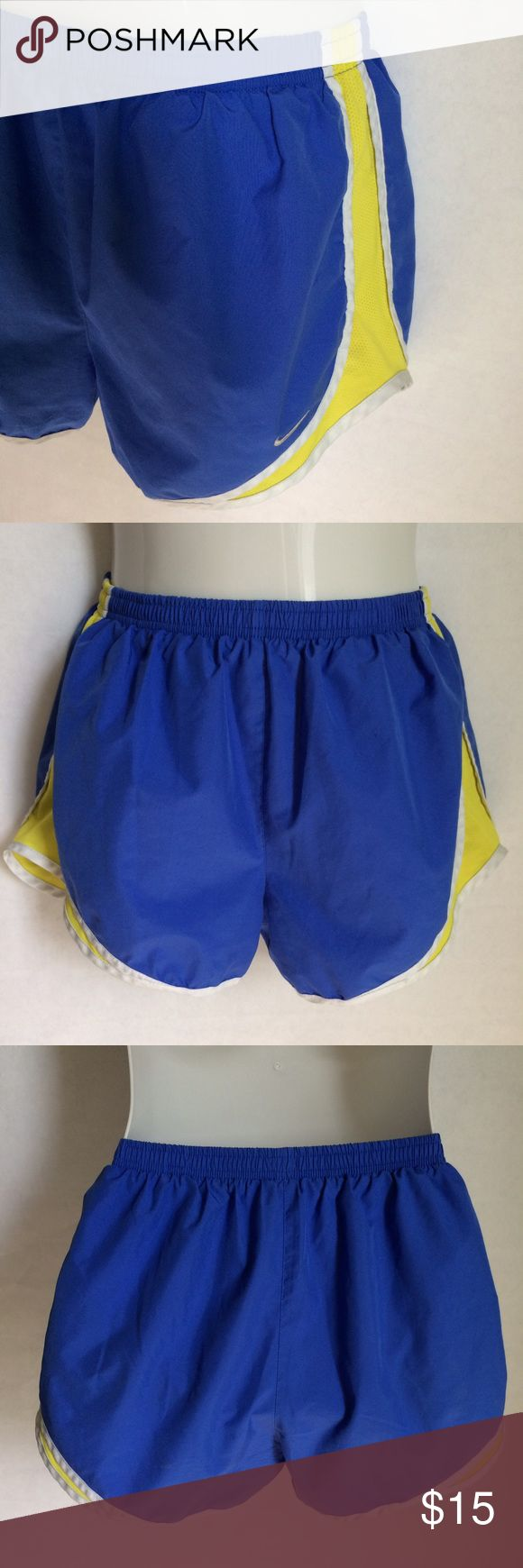 ✨NEW Listing✨Nike Tempo running shorts Nike Tempo Dri-FIT track shorts in royal blue with white trim and bright yellow side panels. Underwear lining. Elastic waistband. Size M. 100% polyester. Not interested in trades. Nike Shorts