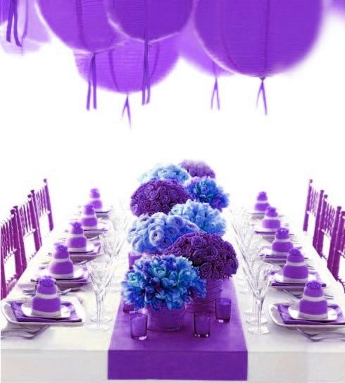 I like the pop of blue among the purple.  I'd put some of that same blue in a couple of the lanterns.  Or maybe blue chairs.
