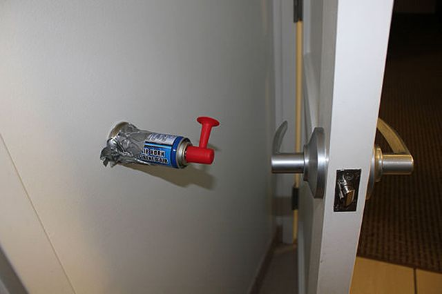 easy april fool's day pranks - Duct tape an air horn as a door stop for a nice wake up