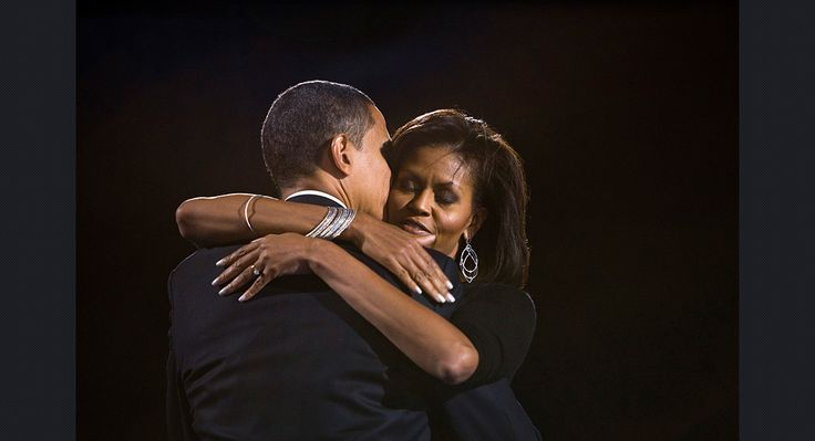 Obama hugs his wife Michelle during his election night rally in Chicago on Nov. 4, 2008.