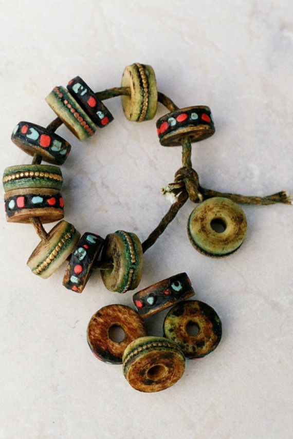 Yak bones. Traditional necklace beads, inlaid with turguoise, coral and/or…