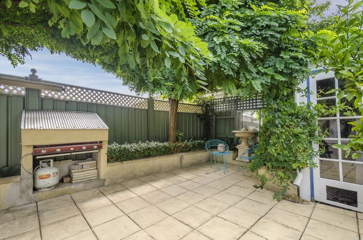 An entirely private outdoor oasis is shaded by mature trees at 110 Dover Road, Williamstown. #Melbre