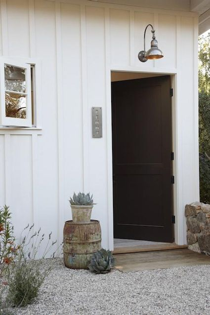 gravel up to a side door, board/batten walls, succulents, barn lighting, window style Love this!!