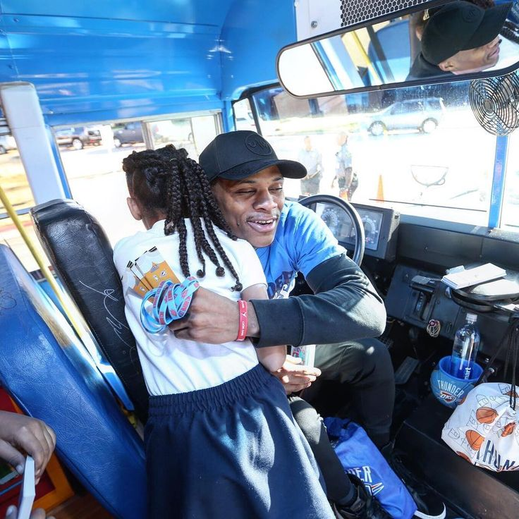 Hugs for Russell Westbrook on the Rolling Thunder Book Bus!