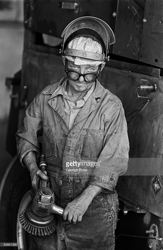 A steel factory worker takes a break from grinding metal in this 1975 Pomona, California, photo depicting the American worker.