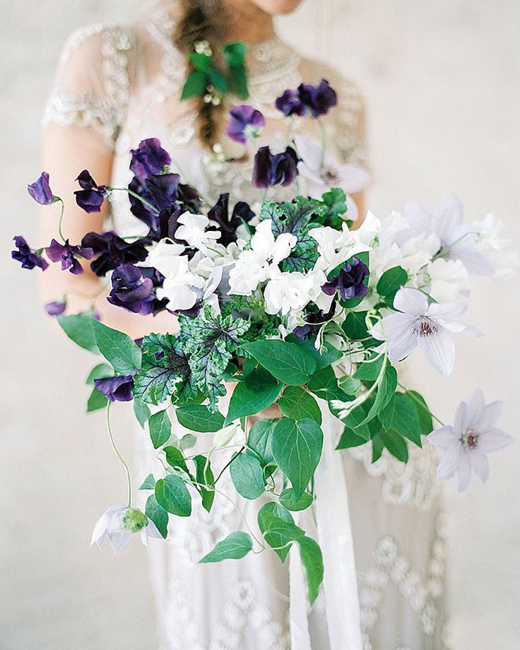 amazing wild cascading bridal bouquet with dark purple sweet peas and lavender clematis! | captured by Ashley Ludaescher