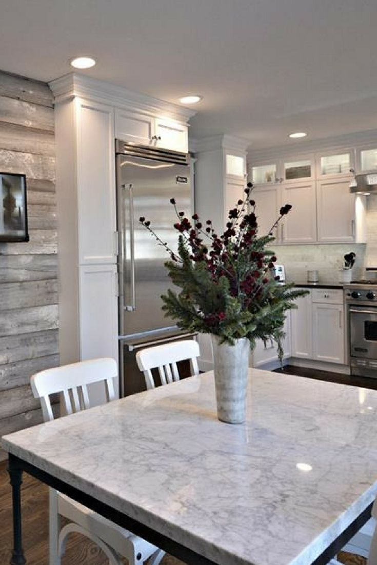 2017 flooring and kitchen trends. White kitchen, dark floors, white countertops and table, gray shiplap wall