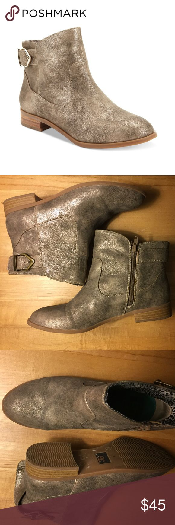"""BC Footwear Building Blocks Metallic Ankle Boot A sloping top line and buckle detail lend modern touches to this metallic low cut ankle boot by BC Footwear Building Blocks. Synthetic sole. Shaft measures approximately 5.5"""" from arch. Heel measures approximately 1.5"""" . Boot opening measures approximately 10.75"""" around. 🚫No trades🚫 BC Footwear Shoes Ankle Boots & Booties"""