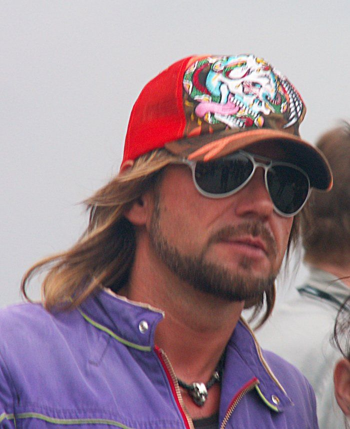 Stephan Weidner of former band Böhse Onkelz - There is something very alluring and sexy about a good looking jawline bearded guy with flowing shoulder length hair. Especially when he is wearing a baseball cap and aviator style shades.