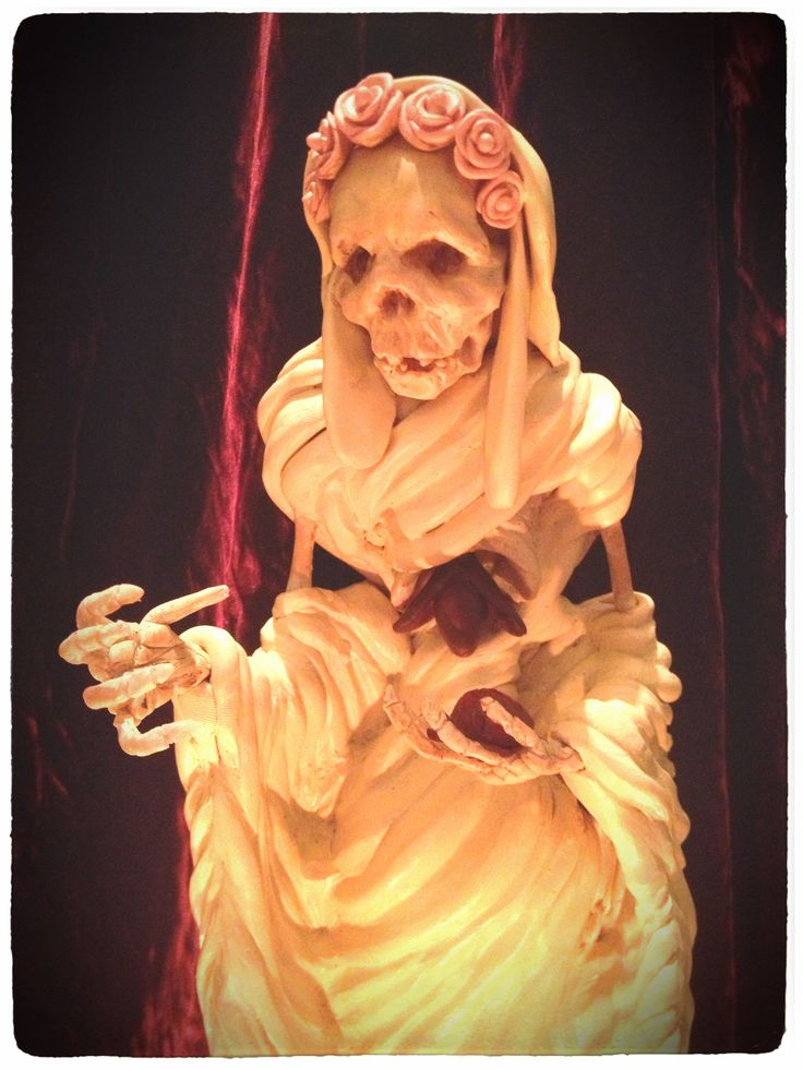 Detail of Santa Muerte statue made by T. Chambers for wolf-and-goat.com