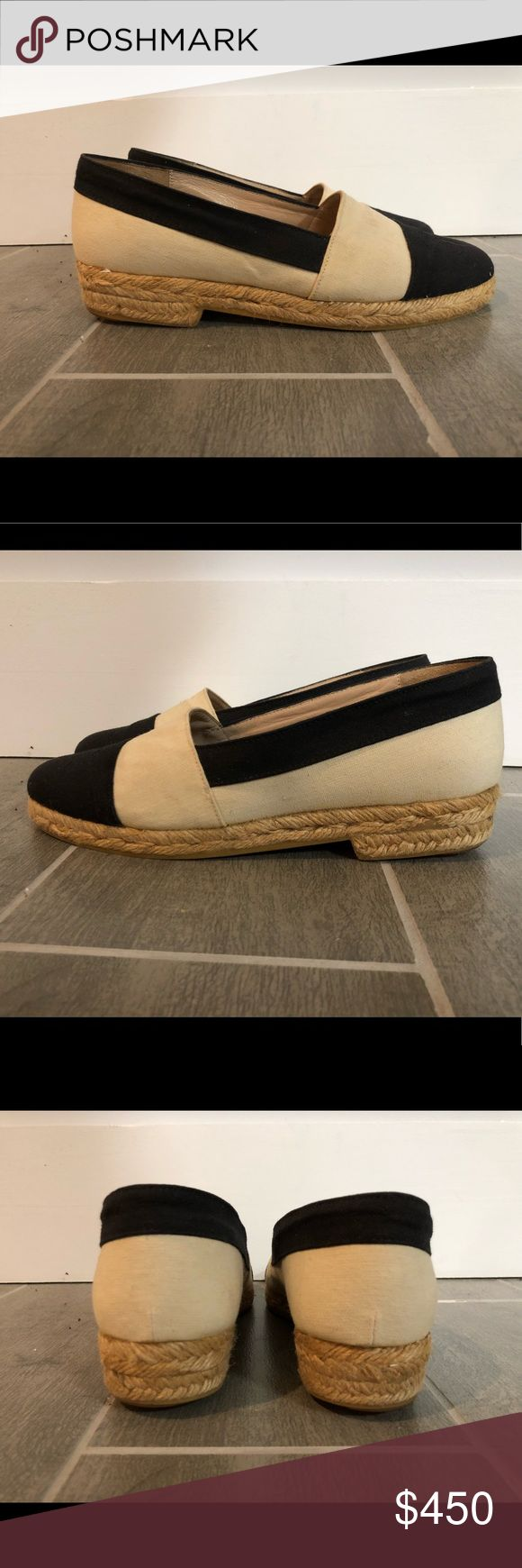 CHANEL s38 black & cream cap toe canvas espadrille Beautiful, comfortable, sophisticated Chanel espadrille flats constructed of canvas. 'CC' logo embroidered on the toe box. Features short platform and small heel. Leather insole, canvas & rubber exterior. CHANEL Shoes Espadrilles