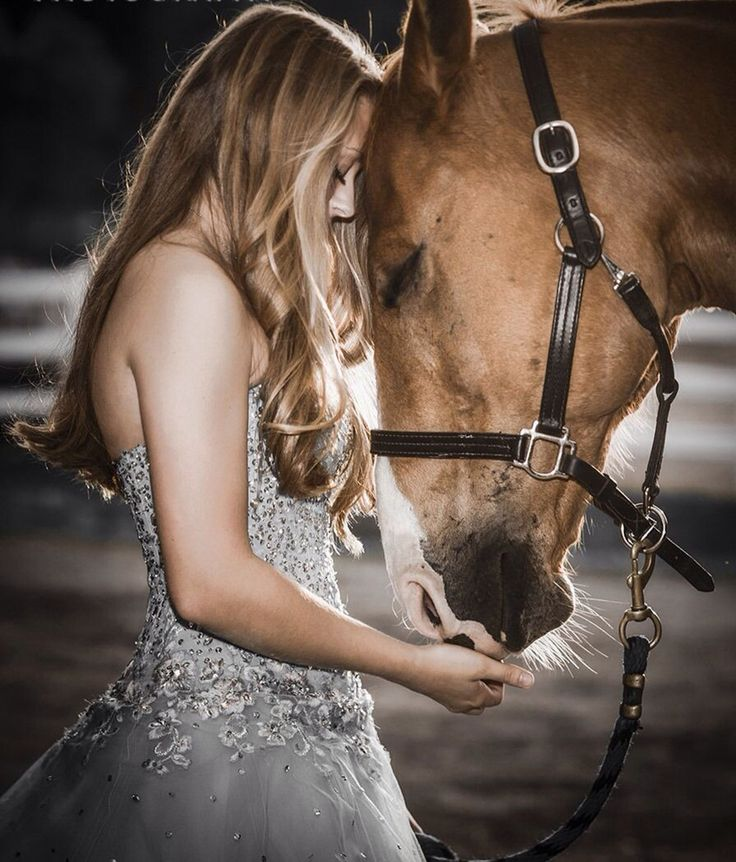 Beautiful lady head to head with her pretty horse. Sweet bonding moment. Beautiful dress, and the beach...yes.