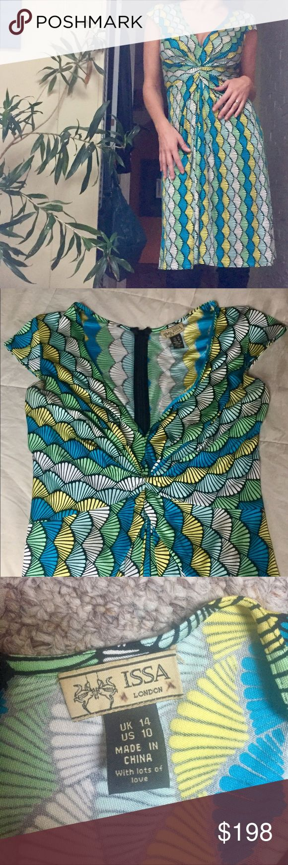 Beautiful Silk Fan Print Issa of London Dress👗 This is a gorgeous silk short sleeve knee length Issa of London silk dress with a plunging neckline. zips up the back. Feels sublime on the skin! Gorgeous aqua/blue/yellow/and black print. Has only been worn on a few occasions! Women's size 10. So feminine and flattering! Issa of London Dresses Maxi