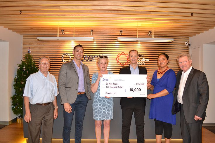 The 2014 Unsung Hero Charity - De Paul House receiving their cheque! http://ow.ly/KKUy1