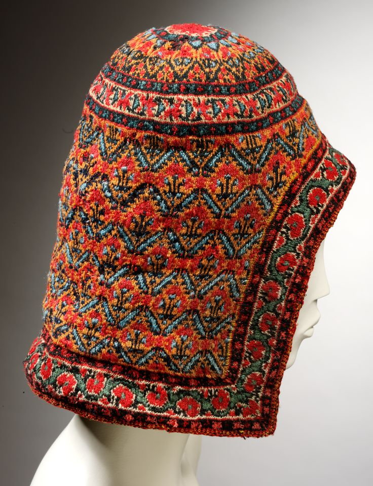 Hood | Ludhiana, Punjab, India | Mid 19th century | Knitted wool lined with coarser undyed knitting | Knitting is not a craft traditional to India, but was introduced by Europeans, probably in the late 18th century | This piece was probably knitted by the Kashmiri immigrants who created the woollen shawls. Kashmiris left their homes because of a famine and settled in Ludhiana in 1833, where the piece originates | VA Museum, London