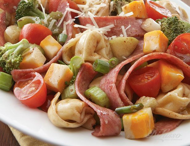 Insalata Di Pasta made with cheese tortellini and a mélange of veggies, meats and cheese #pastasalad