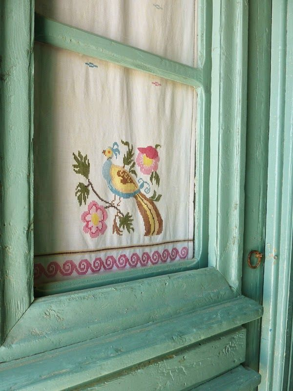 Use vintage linens inside cupboard doors, armoire doors or as curtains.