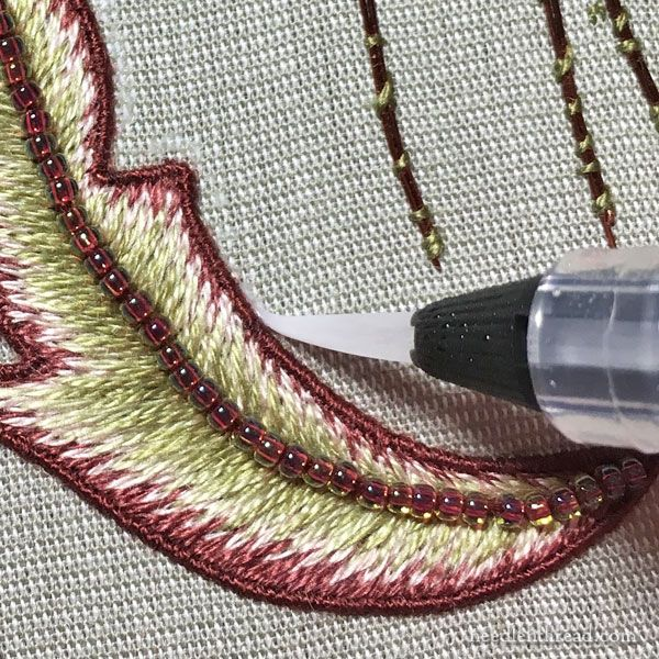 Needle n Thread: The Stumpwork is Finished & Some Tips | Mary Corbet applies fray check with water brush for precision and control.