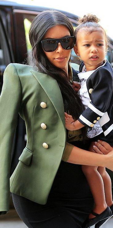 Who made Kim Kardashian's black sunglasses, lace boots, and green jacket?