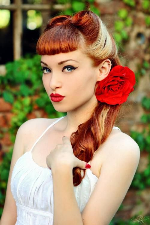Bangs + Rolls - I love her hair color(s) and the make up too. Mandy u could so wear the pin up girl look!