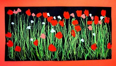 Black paper.  Green oil pastels for grass, stems.  Different color paint with different sized brushes for blooms.