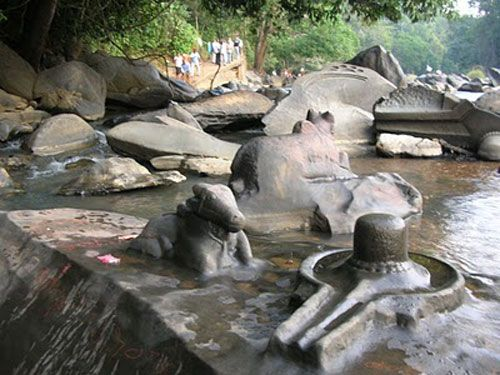 """Sahasralinga is famous for thousand of Shiv lingas. Which are carved on the rocks in the river bank. Sahasralinga is is a famous pilgrim place in """"Uttara kannada"""" of Karnatka in India. One of the most famous temples here is the 16th century Marikamba temple. This site is situated 10 km away from the town of Sirsi on the banks of Shalmala River."""