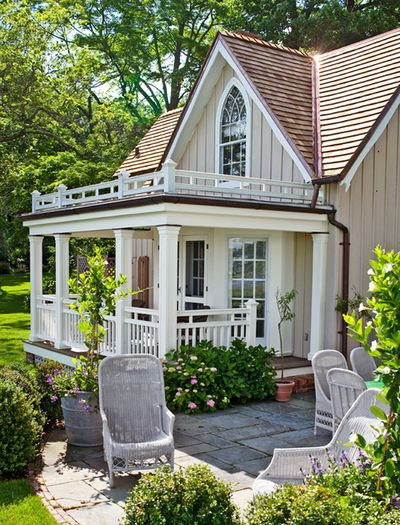I love this covered porch charming white cottage