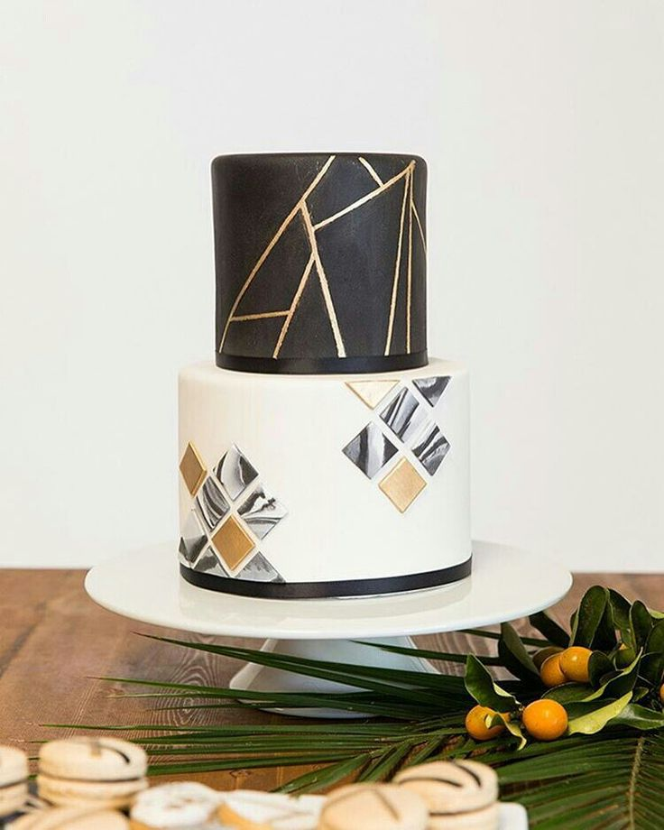 Black, white and gold cake with geometric design