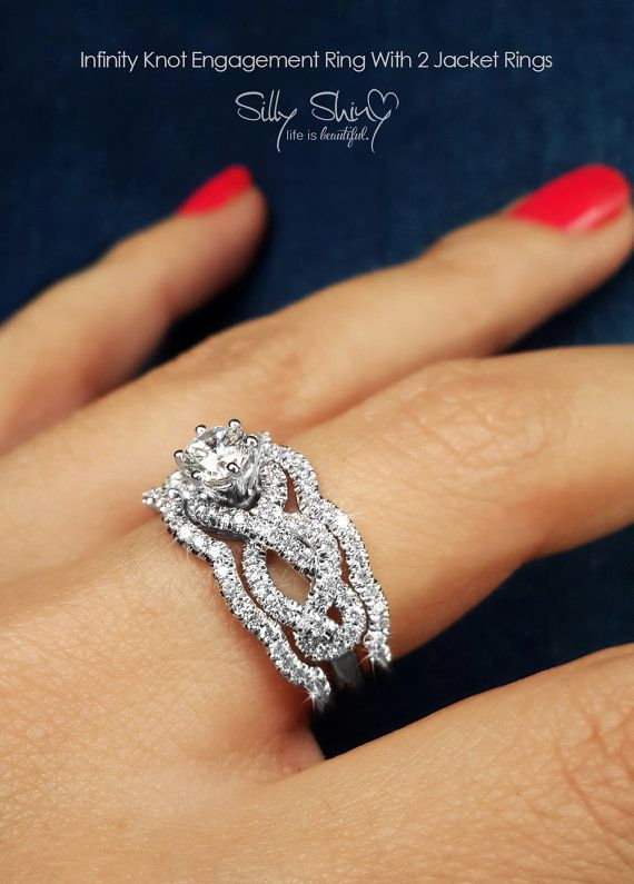Infinity knot solitaire with 2 matching jacket rings by SillyShinyDiamonds on etsy   #So gorgeous
