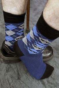 Proper blue argyle clocked with perfectly groomed moustaches, the ultimate sock for the most  meticulous gentlemen.