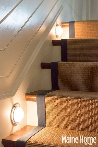 Nautical lights illuminate the stairs. The poly sisal rug with navy linen border doesn't show stains.