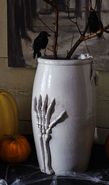 Bone Hand Vase from Pottery Barn--make it yourself with a skeleton hand from the dollar store