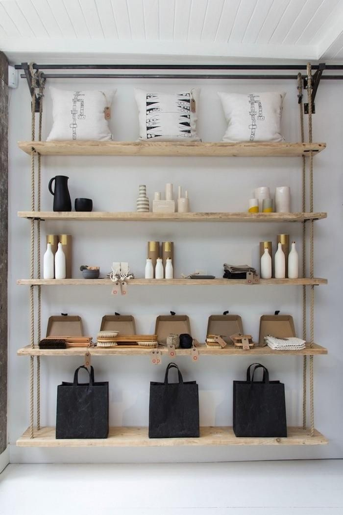 Danielle designed the custom shelving made from sanded scaffolding boards and rope.