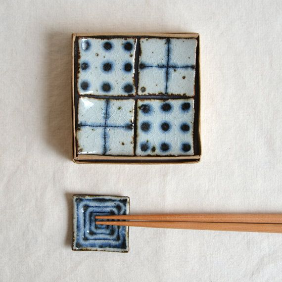 Polka dot Cross and Vortex Chopstick holder set by Bluemics, $50.00
