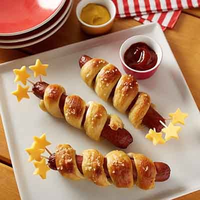 Soft pretzel wrapped hot dogs and star-shaped Deli American, create a lunch perfect for the 4th of July.