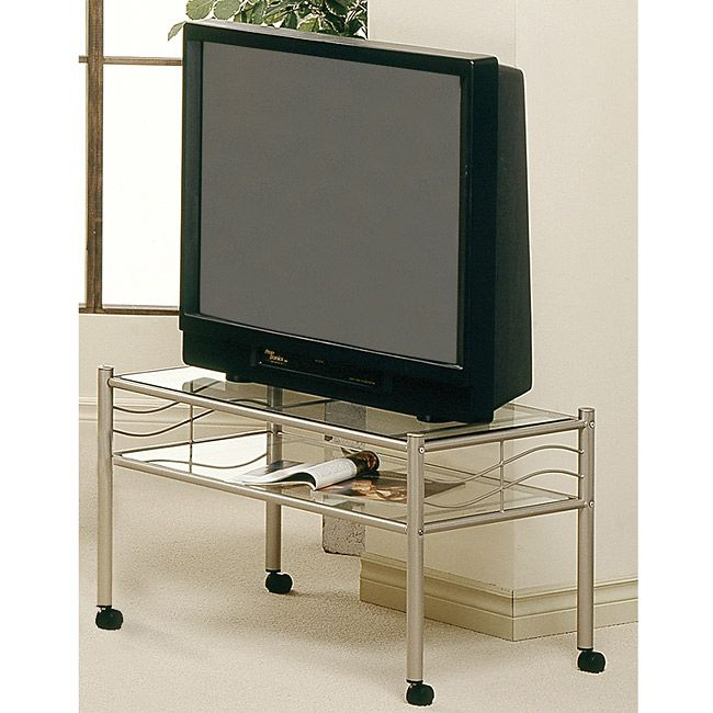 This TV stand features a champagne gold metal construction with two shelves of tempered glass to hold up to a 32-inch television. Bottom casters are included for easy mobility of the stand.