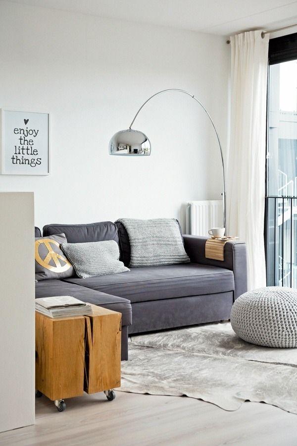 Karlijn de Jong's living room - good small space idea like calm simple palette, white walls, art  coffee / side table on wheels