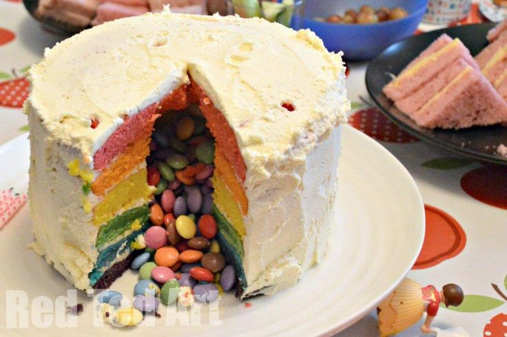 I love Pinterest, it is a wonderfully visual place for inspiration and ideas. Two such ideas popping up a lot, are the gorgeous RAINBOW CAKES and more recently the Pinata Cakes (cakes filled with M&Ms or Smarties). I decided that I wanted to have a go at BOTH for Pip Squeak's 4th Birthday party which …
