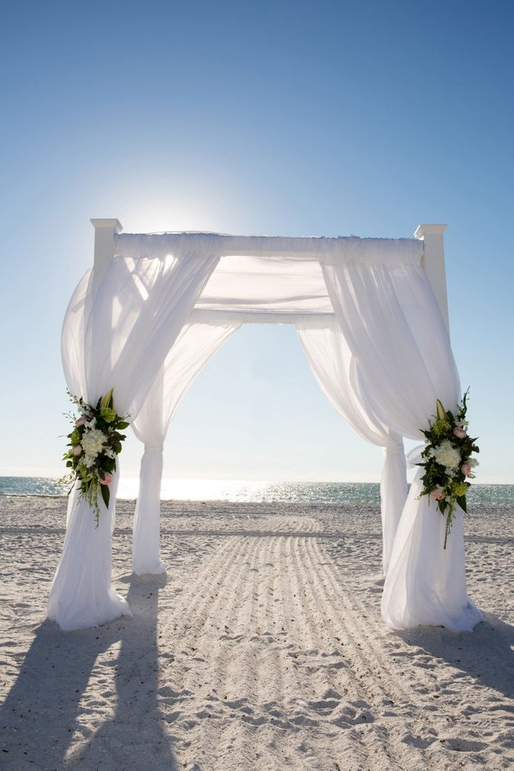 Such a beautiful arch at this beach wedding in Marco island, Florida