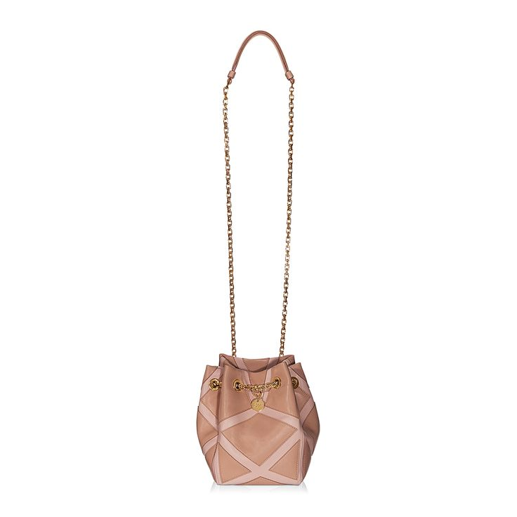 Prismick Bucket Bag in leather with geometric inserts, chain shoulder strap, monogrammed charm and leather interior with pocket. The go-to accessory for an easy-chic look. #THELUXER #ITALIANSTYLE
