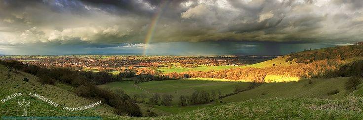 slides/Downland Rainbow.jpg storrington rainbow sun couds strom sussex west south downs way light clouds breaking arable chantry lane rain Downland Rainbow