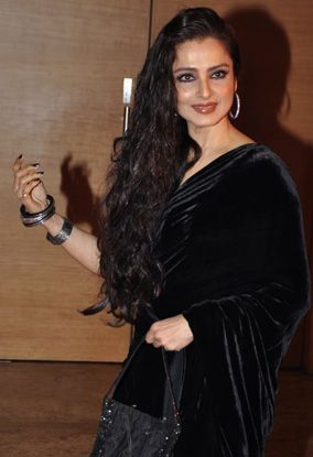 The Indian film actress Rekha in a black velvet saree