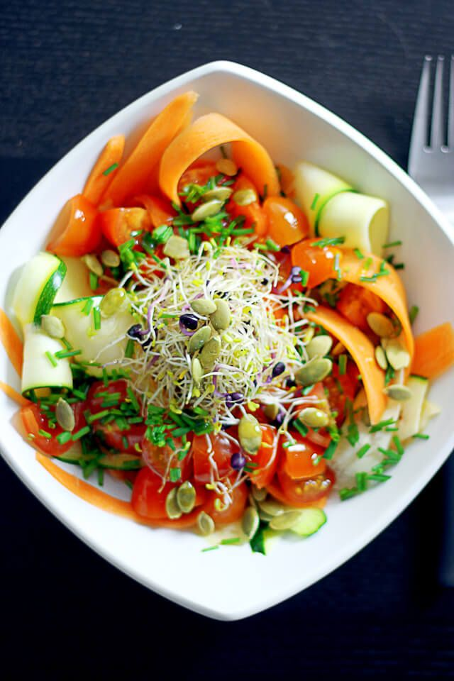 """Carrot and Zucchini Linguini Salad ~ http://steamykitchen.comINGREDIENTS: 4 carrots, peeled 4 zucchini 6 ounces cherry tomatoes, halved 1/4 cup roasted pumpkin seeds or pepitas handful of sprouts few sprigs of chives, minced 4 teaspoons fresh squeezed lemon juice (about 2 lemons) 1/4 cup extra virgin olive oil sea salt and pepper DIRECTIONS: 1. Peel carrot and zucchini lengthwise to create long """"linguine"""" ribbons. Place in bowl of ice water. 2.  Mix wet ingredients.   Pour on all."""