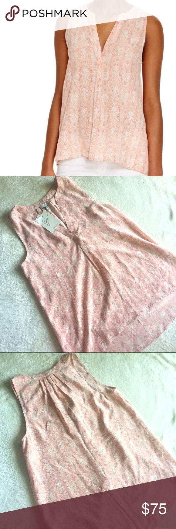 Joie Aruba Printed Silk Tank NWT Joie Aruba Printed Silk Tank. Joie's luxe take on the warm-weather essential features an abstract snakeskin print in a feminine peach palette, crafted from silk that glides fluidly. Retails for $188 Details: 100% Silk Notched round neck with concealed button closure Sleeveless, allover snakeskin print Pleated back detail, high/low hem with rounded back Joie Tops Camisoles
