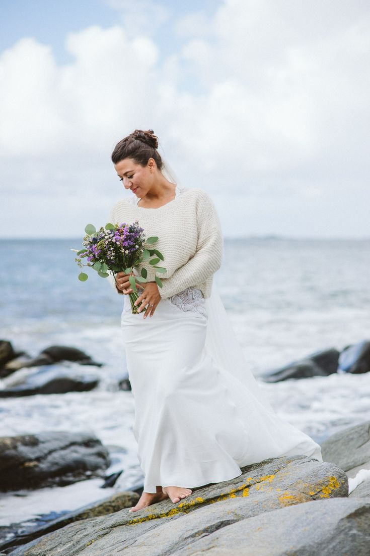 Lovely bridal portrait by the sea, beautiful flowers and ocean tones.