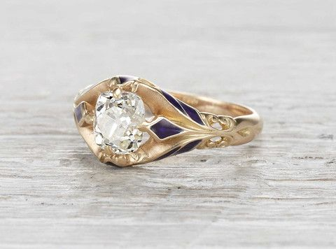 Vintage Victorian engagement ring made in 14k yellow gold and centered with an EGL certified 1.52 carat old mine cushion cut diamond with H-I color and VS2 clarity. Accented with blue enamel. Circa 1890.